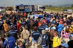 Rally winners Carlos Sainz and Michel Périn celebrate with their team