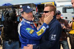 Rally winner Carlos Sainz celebrates