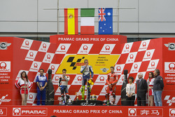 Podium: race winner Valentino Rossi with Dani Pedrosa and Casey Stoner