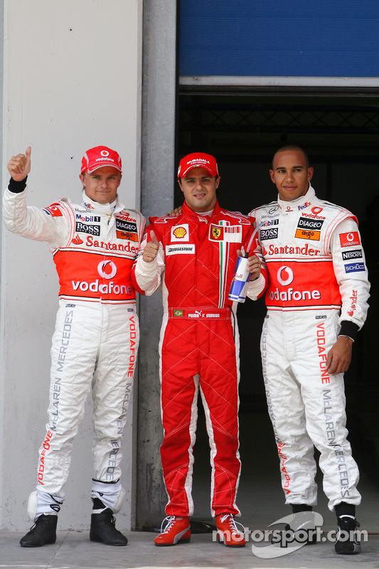Heikki Kovalainen, McLaren Mercedes with pole winner Felipe Massa, Scuderia Ferrari and Lewis Hamilt