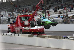Ryan Hunter-Reay's car is returned to the garage area after hitting the wall