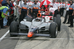 Oriol Servia spins his tires as he pulls out to qualify