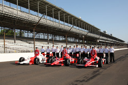 Front row: Ryan Briscoe, Dan Wheldon and pole winner Scott Dixon, pose for pictures with the Honda Racing crew