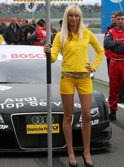 Grid girl in front of the car of Timo Scheider, Audi Sport Team Abt