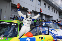 Race winner Romain Dumas celebrates