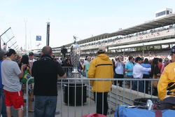 Fans take pictures of the Borg Warner Trophy