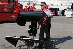 A crew member carting A.J. Foyt IV's extra wings