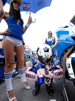 Valentino Rossi and his charming grid girl
