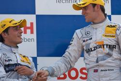 Podium: race winner Jamie Green celebrates with Bruno Spengler