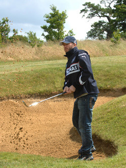 BMW Sauber F1 Team drivers Nick Heidfeld and Robert Kubica play golf at the Whittlebury Park Golf Club near Silversone circuit