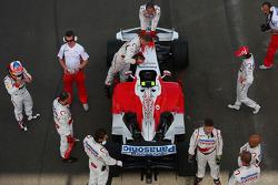 Timo Glock, Toyota F1 Team, TF108 and Jarno Trulli, Toyota Racing