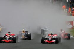 Start of the race: Heikki Kovalainen, McLaren Mercedes leads Lewis Hamilton, McLaren Mercedes and Ma
