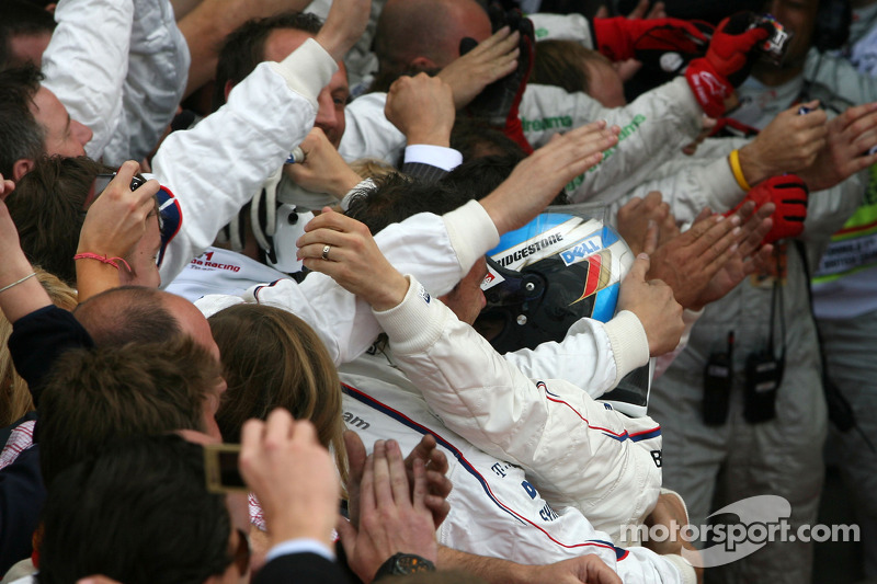 Second place Nick Heidfeld celebrates