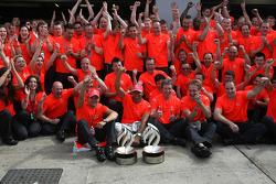 McLaren Mercedes victory celebration: race winner Lewis Hamilton celebrates with Heikki Kovalainen,