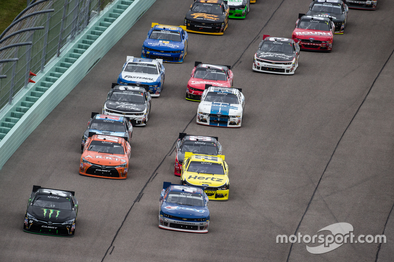 Kyle Busch, Joe Gibbs Racing Toyota and Kyle Larson, HScott Motorsports with Chip Ganassi lead the field