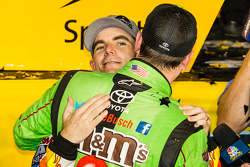 Victory lane: race winner and 2015 NASCAR Sprint Cup series champion Kyle Busch, Joe Gibbs Racing Toyota congratulated by Jeff Gordon, Hendrick Motorsports Chevrolet