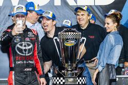 Championship victory lane: NASCAR Camping World Truck Series 2015 champion Erik Jones, Kyle Busch Motorsports celebrates with team owner Kyle Busch