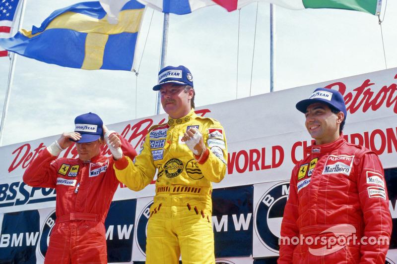 Podium: race winner Keke Rosberg, Williams, second place Stefan Johansson, Ferrari, third place Mich
