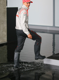 Heikki Kovalainen, McLaren Mercedes wearing wellies