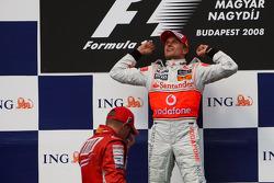Podium: race winner Heikki Kovalainen celebrates