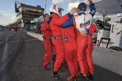 Stevenson Motorsports crew members celebrate GT class win
