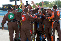 M&M's Toyota crew members celebrate victory