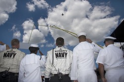 The Navy crew listens to the anthem