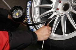 Audi Sport Team Joest team member takes tire pressure