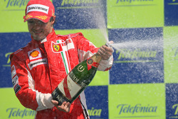Podium: race winner Felipe Massa celebrates with champagne