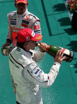 Podium: Robert Kubica celebrates with champagne