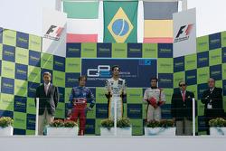 Lucas di Grassi celebrates his victory on the podium with Luca Filippi and Jerome D'Ambrosio