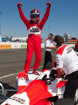 Helio Castroneves celebrates winning the pole