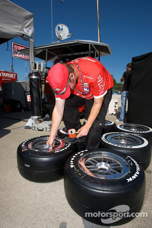 Ganassi Racing team member prepares the wheels