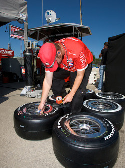 Ganassi Racing team member prepares the wheels