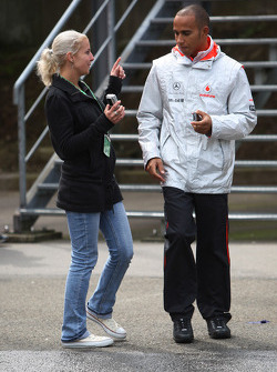 Lewis Hamilton, McLaren Mercedes with a girl in the paddock