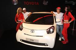 Timo Glock, Toyota F1 Team and Jarno Trulli, Toyota Racing with a Toyota IQ