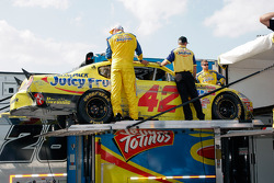 The #42 crew load up the car following the race