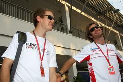 Sebastian Vettel, Scuderia Toro Rosso and Jarno Trulli, Toyota Racing