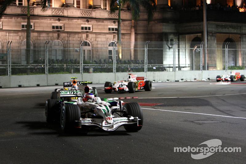 Rubens Barrichello, Honda Racing F1 Team, RA108; Nelson Piquet Jr., Renault F1 Team, R28