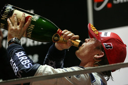 Podium: champagne for Nico Rosberg