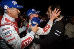 Race winners Allan McNish and Rinaldo Capello celebrate with Dario Franchitti