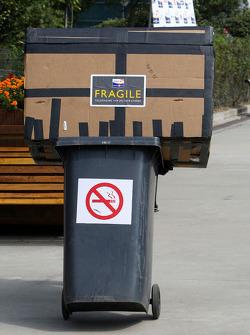 A fragile box on a bin