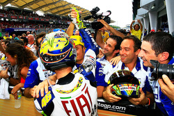 Race winner Valentino Rossi celebrate with Fiat Yamaha Team members