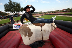 Scott Speed hangs on during his maiden ride on a mechanical bull in the Fort Worth Stockyards