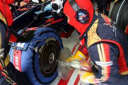 Scuderia Toro Rosso crew members in the garage