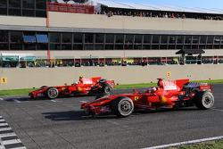 Felipe Massa and Kimi Raikkonen in the Ferrari F2008