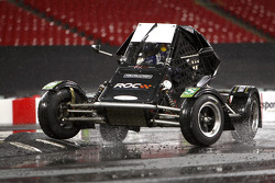 David Coulthard puts a wheel on the kerb in an RX150 Buggy