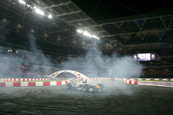 David Coulthard demonstrates his Red Bull F1 car for the crowd