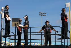 Penske Racing Dodge crew members watch practice from atop their hauler
