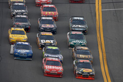 Martin Truex Jr., Earnhardt Ganassi Racing Chevrolet and Tony Stewart, Stewart-Haas Racing Chevrolet lead a group of cars
